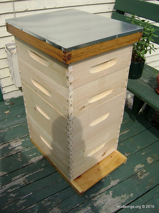 Two completed deeps over a bottom board with two medium supers and a top cover on top. In other words, a completed hive (minus the frames).